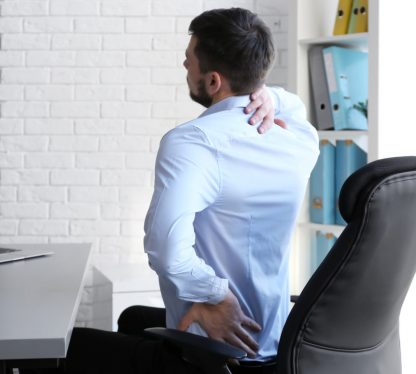 health risks of sitting too long at a desk all day include lower back, neck and hip pain